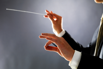 Orchestra conductor - Man directing with his baton in concert