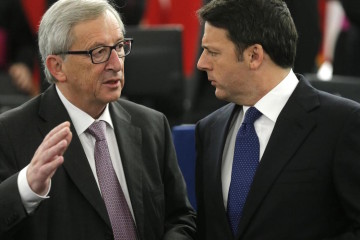 Jean-Claude Juncker, left, President of the European Commission, and Italy's Prime Minister Matteo Renzi discuss at the European Parliament, Tuesday Nov. 25, 2014 in Strasbourg, eastern France. (AP Photo/Christian Hartmann, Pool)
